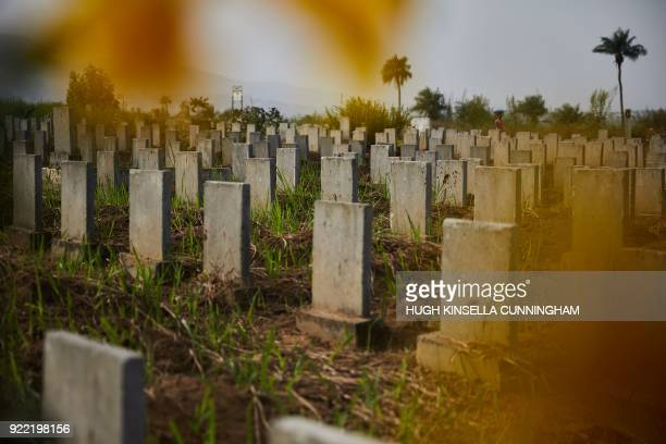 Headstones line the Waterloo Ebola graveyard in Waterloo, Sierra Leone on December 14, 2017. - The 2014-16 outbreak of the highly contagious and...