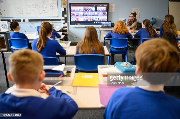 Headteacher Shelley Desborough presents an online assembly, broadcasted to each bubble, as classes return to Gamlingay Village Primary on March 08,...