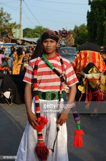 A healer holding a whip as an aid to healing performers how have gone into a trance and become 'possessed' in a traditional art performance known as...