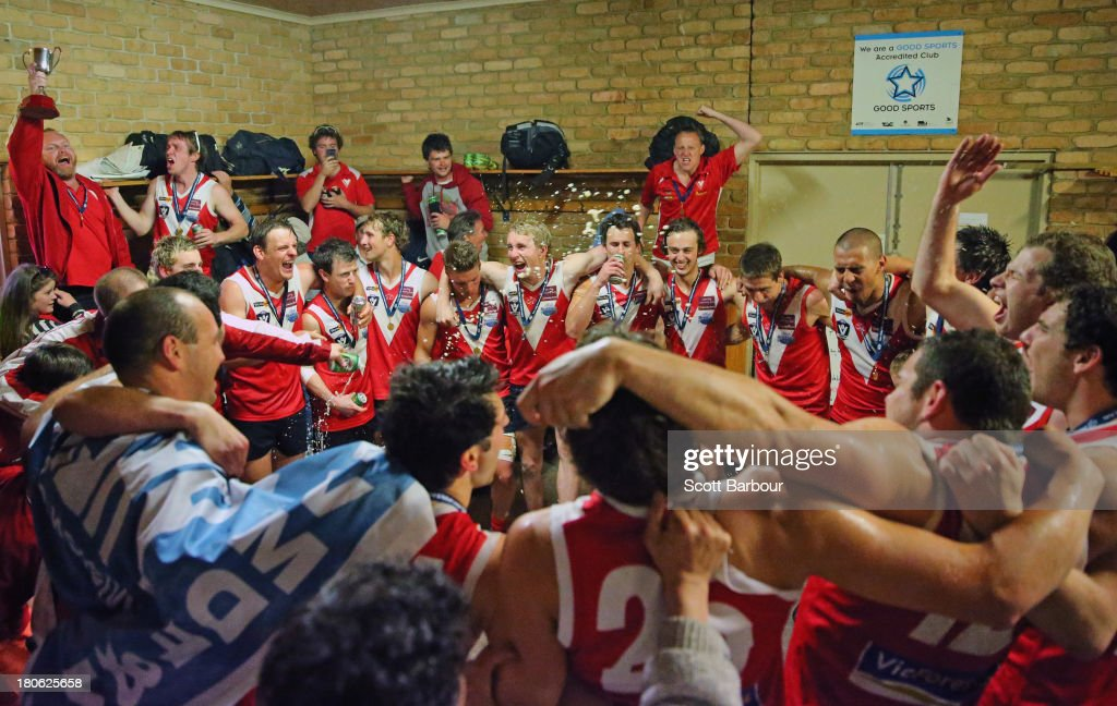 Healesville players celebrate in the changing rooms after winning the Yarra Valley Mountain District Football League Division 2 Seniors Grand Final between Healesville and Seville at Yarra Junction Football Ground on September 14, 2013 in Melbourne, Australia.