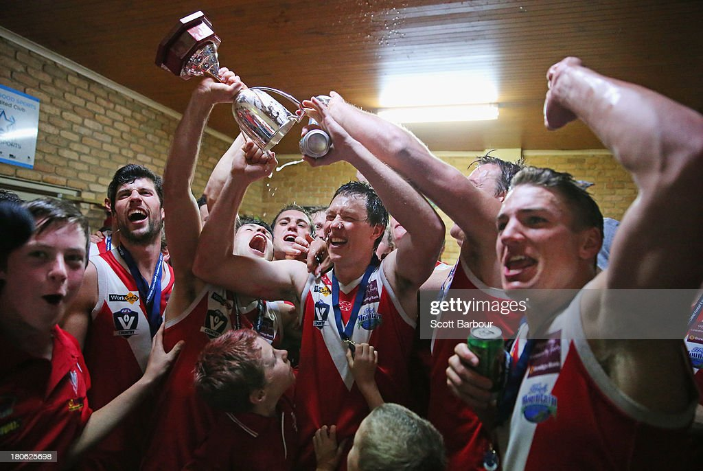 Healesville players celebrate with the trophy in the changing rooms after winning the Yarra Valley Mountain District Football League Division 2 Seniors Grand Final between Healesville and Seville at Yarra Junction Football Ground on September 14, 2013 in Melbourne, Australia.