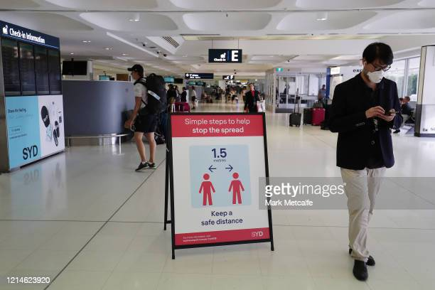Health advice notices are seen at Sydney International Airport on March 25 2020 in Sydney Australia Prime Minister Scott Morrison has announced...