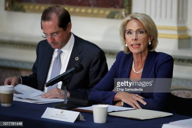 S Health and Human Services Secretary Alex Azar and Education Secretary Betsy DeVos participate in a meeting of the Federal Commission on School...