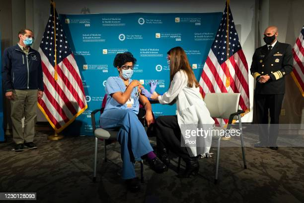 Health and Human Services Secretary Alex Azar and U.S. Surgeon General Dr. Jerome Adams watch as Dr. Sheetal Sheth, center left, OB-GYN and Medical...