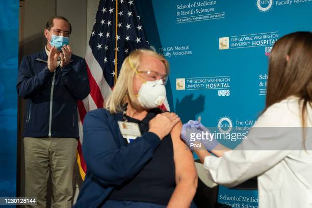 Health and Human Services Secretary Alex Azar , applauds as nurse Lillian Wirpsza administers a COVID-19 vaccine to emergency department nurse...