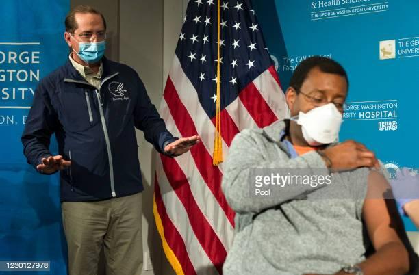 Health and Human Services Secretary Alex Azar asks Dr. Raymond Pla, an anesthesiologist at George Washington University Hospital, how his vaccination...