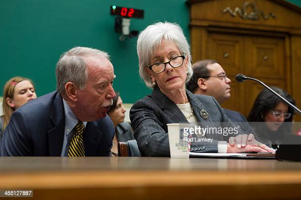 Health and Human Services Secretary Kathleen Sebelius confers with a member of her staff as she testifies during a House Health Subcommittee hearing...