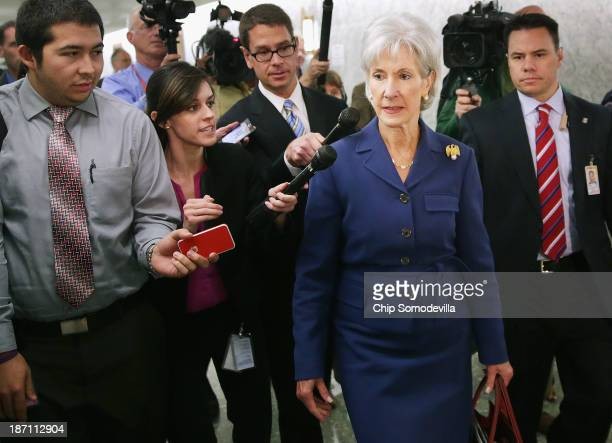 Health and Human Services Secretary Kathleen Sebelius is pursued by reporters after testifying before the Senate Finance Committee about the...