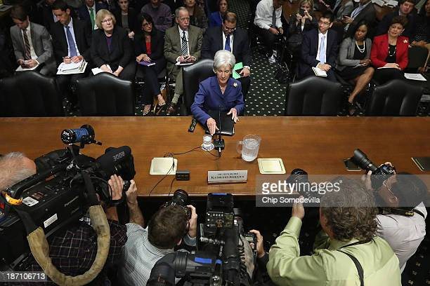 Health and Human Services Secretary Kathleen Sebelius prepares to testify about the errorplagued launch of Healthcaregov while testifying before the...