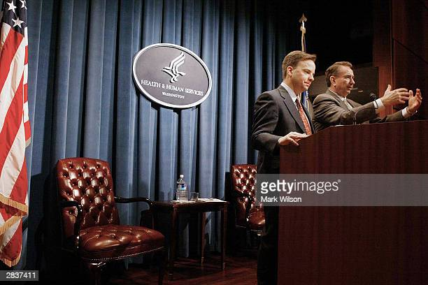 Health and Human Services Secretary Tommy Thompson and FDA Commissioner Mark B McClellan make remarks during a news conference December 30 2003 in...