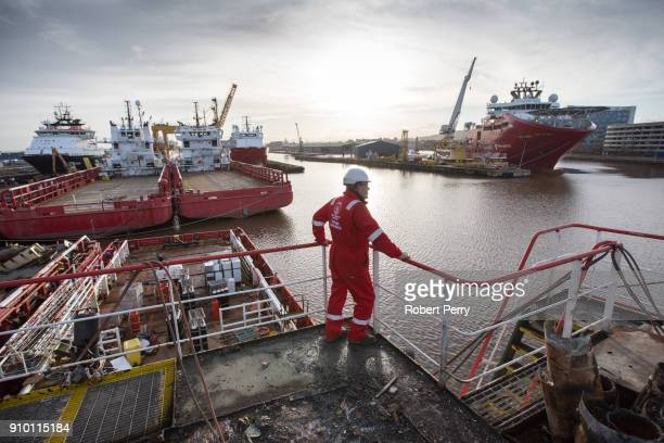 Health and Safety officer looks out over the decommissioned ship Lismore in Leith's Imperial Dry Dock on January 25 2018 in Leith Scotland The...