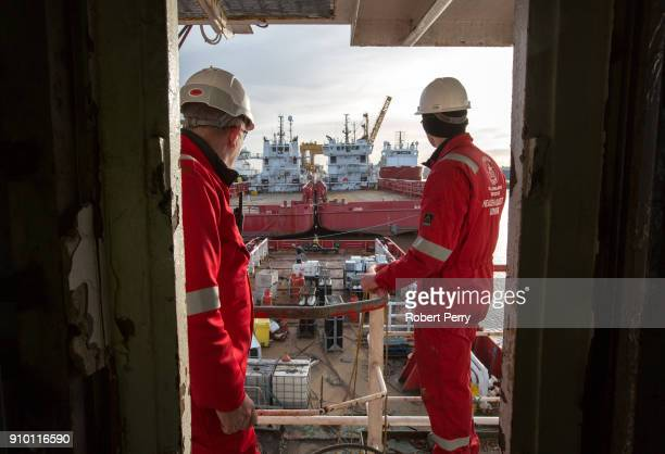 Health and Safety officers look out over the decommissioned ship Lismore in Leith's Imperial Dry Dock on January 25 2018 in Leith Scotland The...