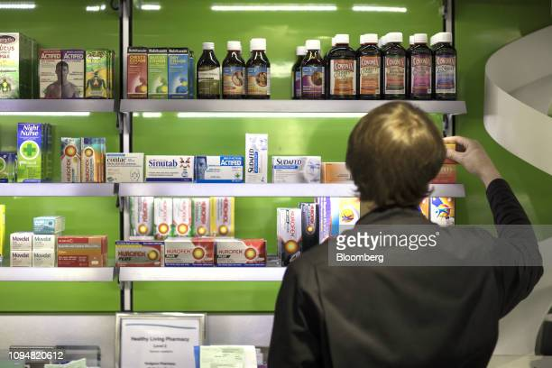 A Health and Wellbeing consultant checks overthecounter medications on a shelf inside Hodgson Pharmacy in Longfield Kent UK on Tuesday Feb 5 2019...