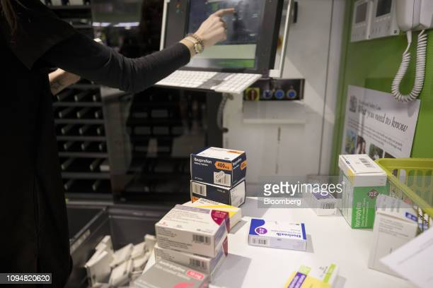 A Health and Wellbeing consultant checks packets of prescription medications before loading into the ingest tray of the robotic vending machine built...