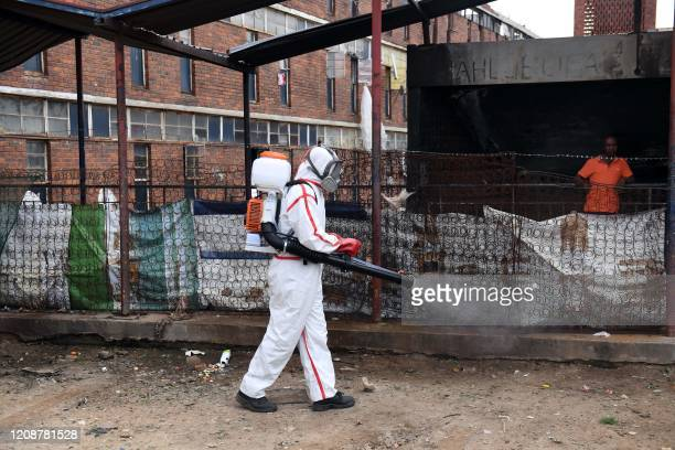 Health authorities disinfect the Madala hostel in Alexandra, Johannesburg, on April 1 as the government is trying to control the outbreak of the...