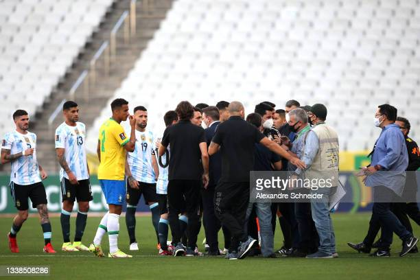 Health authorities interrupt the match as they argue with players of Brazil and Argentina during a match between Brazil and Argentina as part of...