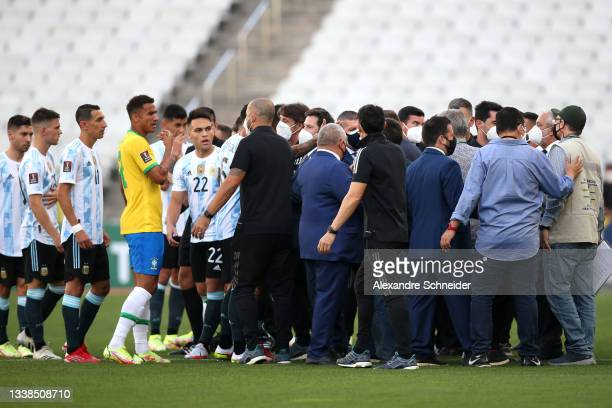 Health authorities interrupt the match as they argue with players of Argentina and Brazil during a match between Brazil and Argentina as part of...