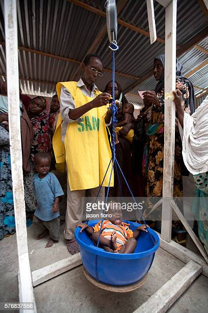 A SAACID health care center for children under 5 years old in Mogadishu supplies medicine and checks the weight of infants to make sure they are not...