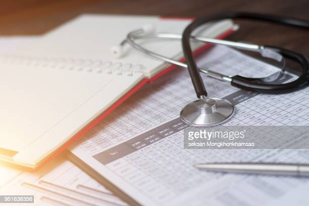 health care costs. stethoscope and calculator symbol - bill legislation stock pictures, royalty-free photos & images