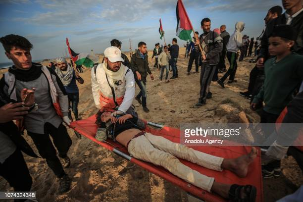 Health care members carry a wounded boy after Israeli interventions during a gathering to support the maritime protest against Israels ongoing...