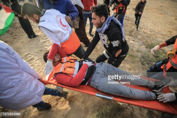 Health care members carry a wounded colleague after Israeli interventions during a gathering to support the maritime protest against Israels ongoing...