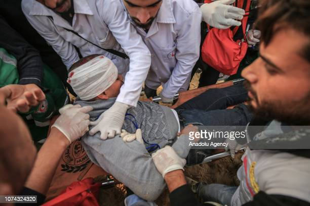 Health care members carry a wounded man after Israeli interventions during a gathering to support the maritime protest against Israels ongoing...