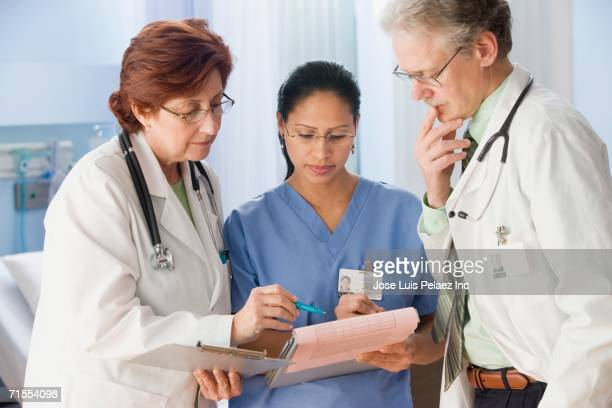 Health care professionals looking at chart