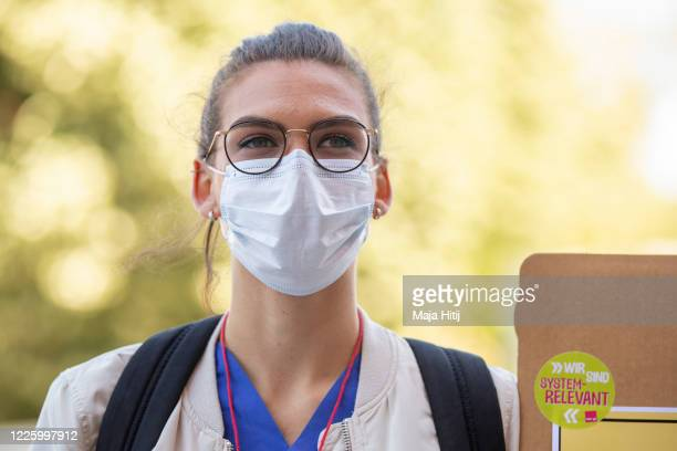 Health care worker represented by the Verdi labour union protests as they arrive to hand over thousands of letters from health care workers to city...