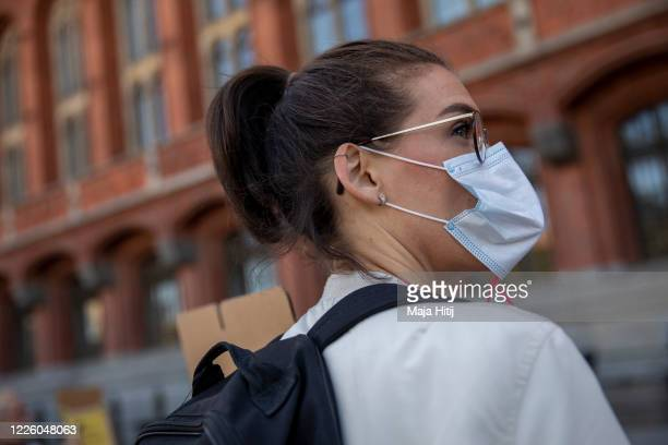 A health care worker represented by the Verdi labour union protests as they arrive to hand over thousands of letters from health care workers to city...