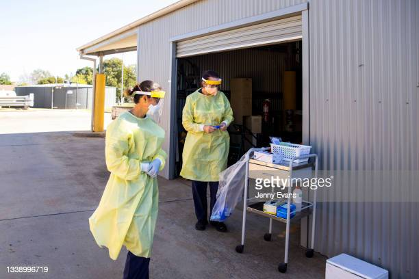 Health care workers are seen at a COVID-19 testing clinic on September 08, 2021 in Nyngan, Australia. New freedoms have been announced for fully...