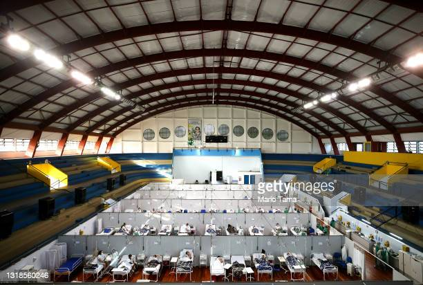 Health care workers care for COVID-19 patients at a field hospital set up in the Pedro Dell'Antonia Sports Complex on May 17, 2021 in Santo Andre,...