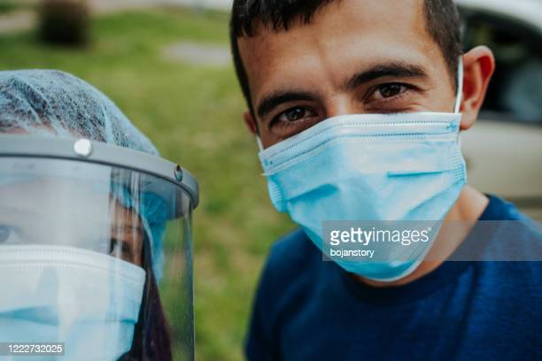 health care workers during a break - frontline worker stock pictures, royalty-free photos & images