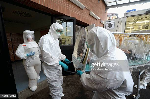 Health care workers go through an emergency simulation Ebola exercise on November 12 2014 in Milan Italy In the exercise an Ebola patient is...
