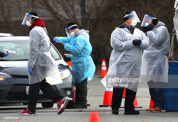 Health care workers on hand as they administer COVID-19 tests in the parking lot at McCoy Stadium in Pawtucket, RI on Dec. 8, 2020.