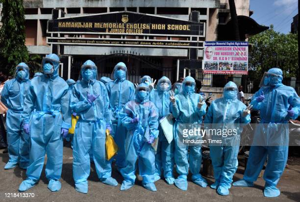 Health care workers ready to check the temperature in the Dharavi slum area during nationwide lockdown to control the spread of the Coronavirus, on...