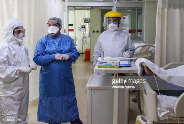 Health care workers wearing protective suits and masks do routine care and control of a coronavirus patient at intensive care unit of the Dr. Lutfi...