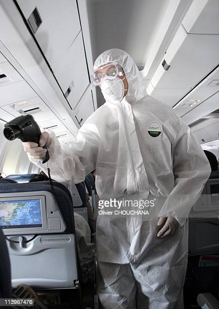 Health chinese authorities check passengers from a Vancouver flight for potential case of H1N1at Beijing Airport in Beijing, China On July 04,...