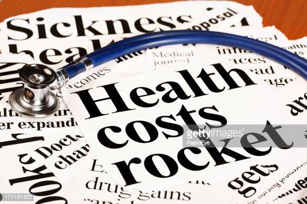 Health cost press headlines with medical stethoscope on desk