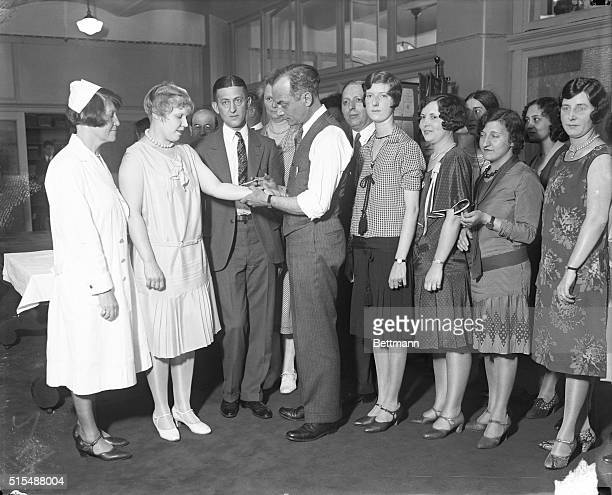 Health Department employees receive Schick testDr Shirley Wynne New York Health Commissioner is pictured giving Brace Higgins and other members of...