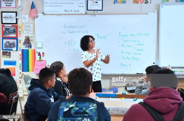 Health Education teacher Leticia Jenkins speaks to her class of ninth graders at James Monroe High School in North Hills California on May 18 where...