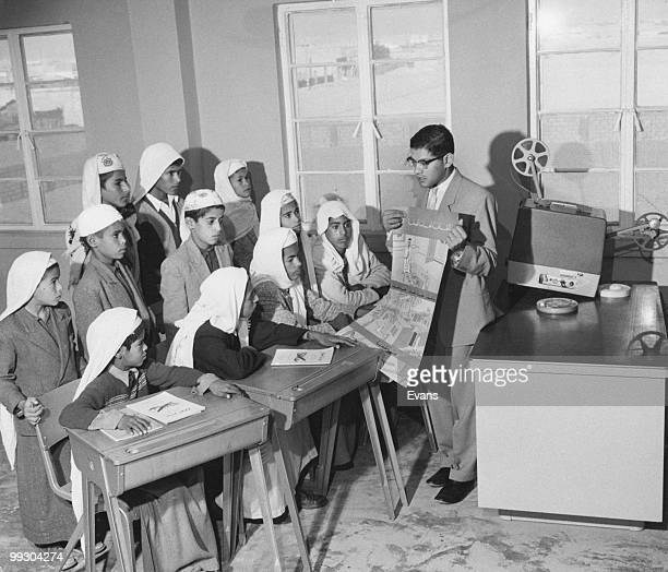 A health educator giving a class in preventive medicine at a school built and maintained by the Arabian American Oil Company for the sons of its...