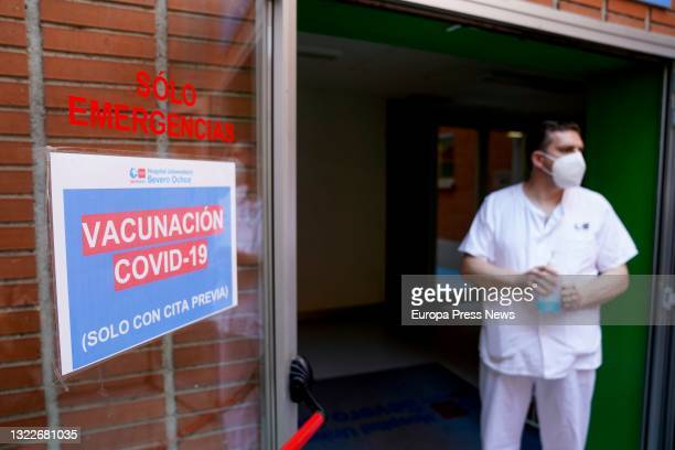 Health employee next to a sign of the vaccination device put in place to inoculate the first dose of the Pfizer-BioNTech vaccine against Covid-19, on...