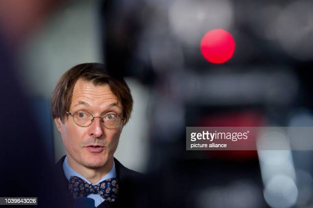 Health expert KarlLauterbach gives an interview during health negotiations for the coalition talks between the CDU/CSU and SPD in Berlin, Germany,...