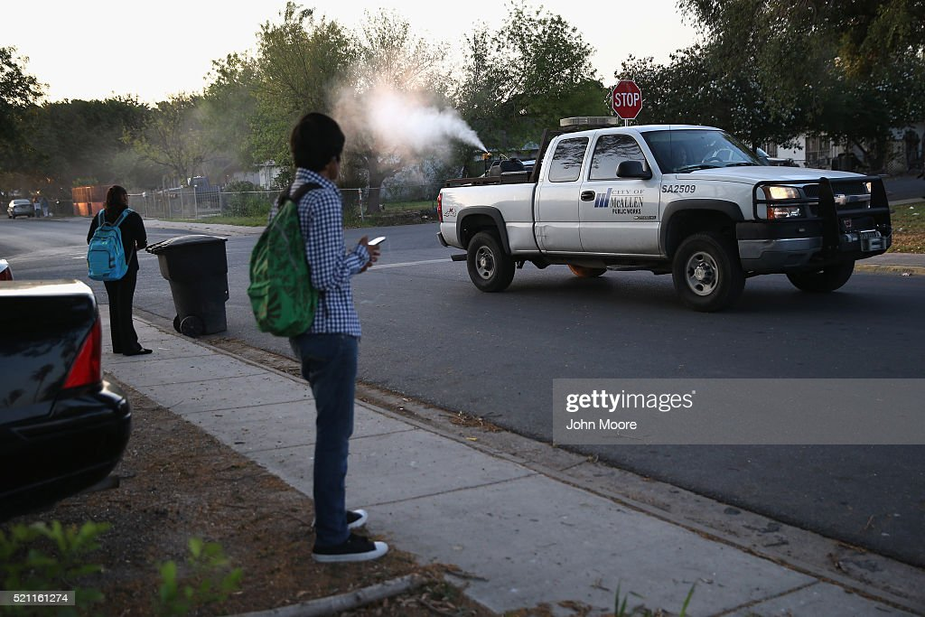 A health inspector sprays a neighborhood for mosquitos early on April 14, 2016 in McAllen, Texas. Health officials, especially in areas along the Texas-Mexico border, are preparing for the expected arrival of the Zika virus, carried by the aegypti mosquito, which is endemic to the region. The Centers for Disease Control (CDC), announced this week that Zika is the definitive cause of birth defects seen in Brazil and other countries affected by the outbreak.