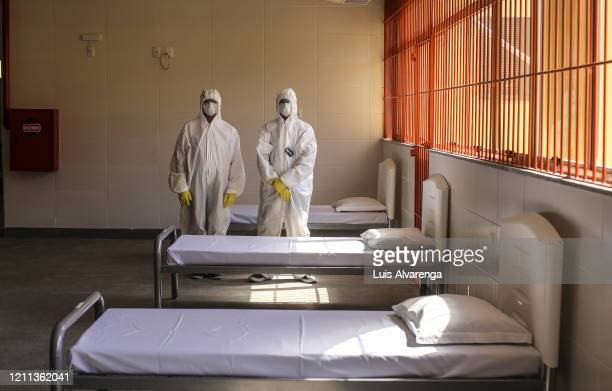 Health members pose during the opening of Niterói City Hall Brazil's first quarantine center amid the coronavirus pandemic at the Ciep Esther Botelho...
