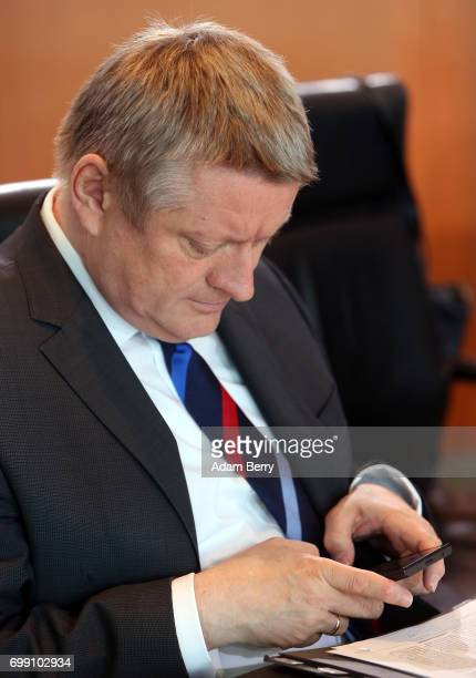 Health Minister Hermann Groehe uses his mobile phone as he arrives for the weekly German federal Cabinet meeting on June 21 2017 in Berlin Germany...