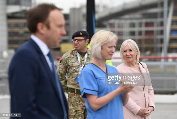 Health minister Nadine Dorries and Britain's Health Secretary Matt Hancock attend the opening of the NHS Nightingale field hospital created at the...