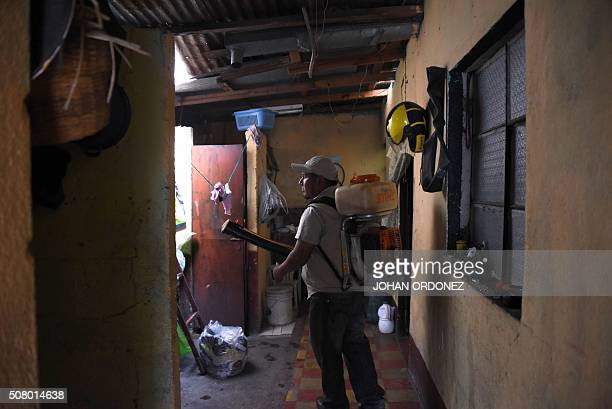 A Health ministry worker fumigates a home against the Aedes aegypti mosquito vector of the dengue Zika and Chikungunya viruses in Bethania...