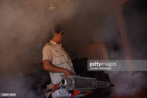Health ministry workers fumigate a home against the Aedes aegypti mosquito vector of the dengue Zika and Chikungunya viruses in the Bethania...