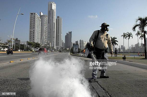 Health ministry workers fumigate against the Aedes aegypti mosquito vector of the dengue Zika and Chikungunya viruses in downtown Panama City on...